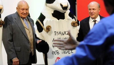 FILE - In this Monday, Dec. 14, 2009 file picture, Chick-fil-a founder Truett Cathy, left, and his son Dan Cathy pose for a photo with the Chick-fil-A cows during a celebration of passi