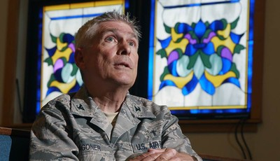 FILE - In this Wednesday, June 27, 2012 file photo, U.S. Air Force chaplain Col. Timothy Wagoner sits in the McGuire Air Force Base chapel at Joint Base McGuire-Dix-Lakehurst in Wrights