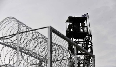FILE - In this Monday, Feb. 6, 2012 Greek soldier is seen on a military observatory tower, on the construction site of a border fence aimed at stemming illegal immigration, in the villa