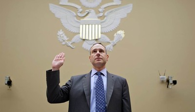 Internal Revenue Service (IRS) Commissioner Douglas Shulman is sworn in on Capitol Hill in Washington, Thursday, Aug. 2, 2012, prior to testifying before the House Oversight Committee.