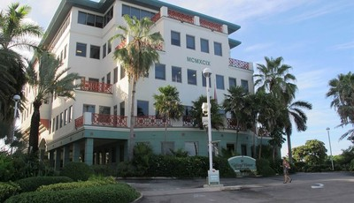In this Aug. 3, 2012 photo, the Ugland House, the registered office for thousands of global companies, stands in George Town on Grand Cayman Island. The Cayman Islands have lost some of
