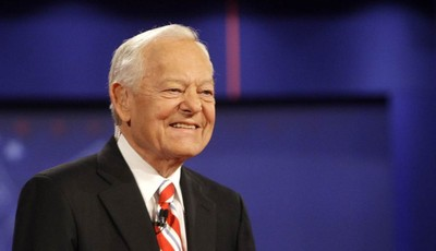 FILE - In this Oct. 15, 2008 file photo, moderator Bob Schieffer smiles at the start of a presidential debate at Hofstra University in Hempstead, N.Y. For the first time in two decades,