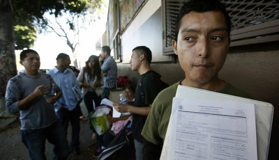 Illegal immigrant Layios Roberto waits outside the offices of Coalition for Humane Immigrant Rights in Los Angeles Wednesday, Aug. 15,  2012.  Hundreds of thousands of young illegal imm