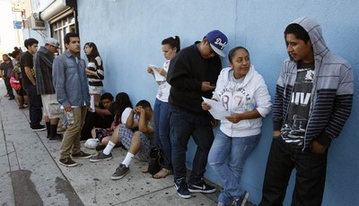 A line of legal immigrants wait outside the Coalition for Humane Immigrant Rights in Los Angeles offices Wednesday, Aug. 15,  2012.  Hundreds of thousands of young illegal immigrants sc