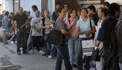A line of illegal immigrants wait outside the Coalition for Humane Immigrant Rights in Los Angeles offices Wednesday, Aug. 15,  2012. Hundreds of thousands of young illegal immigrants s