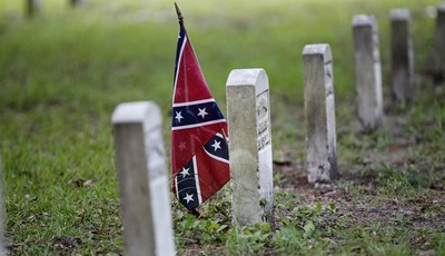 A confederate flag is seen at a tombstone on the cemetery at  Beauvoir House, Jefferson Davis