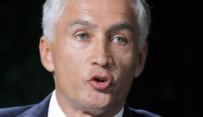 """FILE - In this April 24, 2006 file photo, Jorge Ramos speaks in Las Vegas. Just a month after Forbes Magazine recognized the Hispanic television market as """"the next media jackpot,"""" some"""
