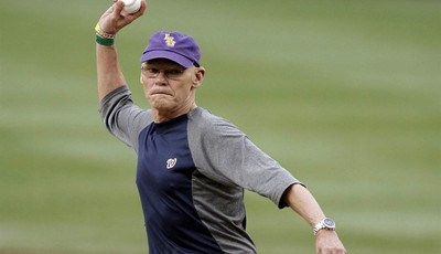 Political consultant James Carville throws out an honorary first pitch before a baseball game between the Washington Nationals and the Atlanta Braves at Nationals Park on Tuesday, Aug.