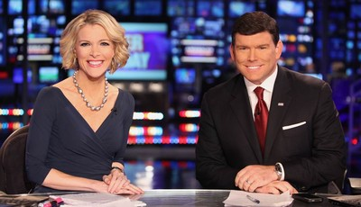 In a March 6, 2012 photo provided by Fox News, Fox News anchors Megyn Kelly and Bret Baier are seated at the anchor desk at the Fox New York Studios.  Four years ago, Megyn Kelly roved
