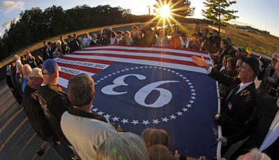 Visitors to the Flight 93 National Memorial in Shanksville, Pa., participate in a sunset memorial service on Monday, Sept. 10, 2012. Tuesday marks the 11th anniversary of the Sept. 11,