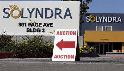 FILE - This Monday, Oct. 31, 2011 file photo shows an auction sign at the bankrupt Solyndra headquarters in Fremont, Calif. before an auction. The bankrupt solar company Solyndra has be