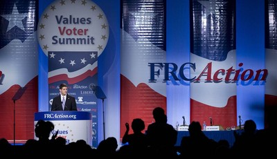 Audience members cheer for Republican vice presidential candidate, Rep. Paul Ryan, R- Wis. as he speaks at  the Values Voters Summit in Washington, Friday, Sept. 14, 2012.  (AP Photo/ E