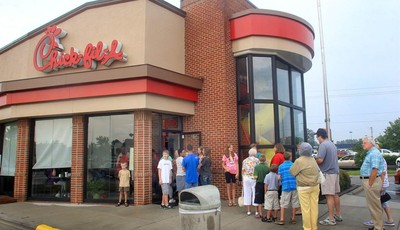 FILE - In this Aug. 1, 2012 file photo, customers line up outside the Chick-fil-A Restaurant at New Bern Mall in New Bern, N.C. It is not entirely clear wether Chick-fil-a has definitel