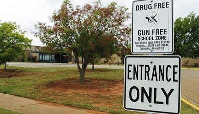 A sign declaring Stillwater Junior High School as a drug free and gun free zone is pictured outside the school in Stillwater, Okla., Wednesday, Sept. 26, 2012.  A 13-year-old student sh