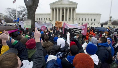 FILE - In this Jan. 23, 2012, file photo, anti-abortion and abortion rights supporters stand face to face in front of the Supreme Court in Washington, Monday, Jan. 23, 2012, during the