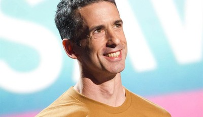 FILE - In this June 13, 2011 file photo, Dan Savage appears onstage at the 15th Annual Webby Awards in New York. TakePart TV, a brand-new YouTube channel launching Tuesday, Oct. 2, 2012
