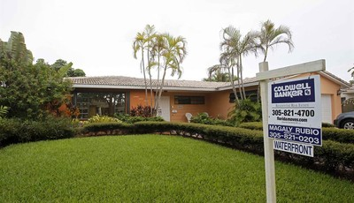 In this Thursday, Sept. 27, 2012 photo, a home for sale is shown in Miami Lakes, Fla. Average U.S. rates on fixed mortgages fell to fresh record lows for the second straight week. The d