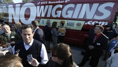 FILE - In this Sept. 24 2012, file photo former Republican presidential candidate Rick Santorum speaks to reporters before the start of a bus tour campaign by Iowans for Freedom that is