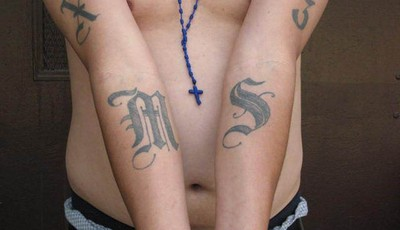 This handout photo provided by US Immigration and Customs Enforcement, taken June 23, 2008 in Washington, shows an example of a tattoo of the gang Mara Salvatrucha (MS-13). The Obama ad