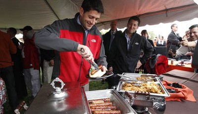 Republican vice presidential candidate, Rep. Paul Ryan, R-Wis., puts food on his plate at a Bowling Green State University and Miami University of Ohio football game tailgate party, Sat