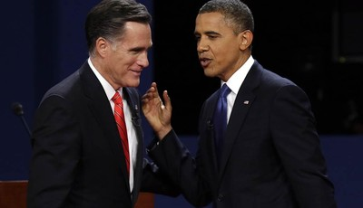 FILE - In this Oct. 3, 2012 file photo, Republican presidential candidate, former Massachusetts Gov. Mitt Romney and President Barack Obama talk after the first presidential debate in D