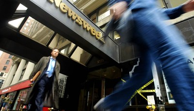 FILE- In this Monday, May 16, 2005, file photo, pedestrians walk past the Broadway entrance to the Newsweek. building in New York. Newsweek announced Thursday, Oct. 18, 2012 that it wil