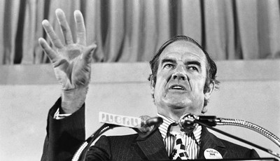 FILE - In this July 30, 1971 file photo, Sen. George McGovern gestures during his keynote address at the National Welfare Rights Organization convention at Brown University in  Providen