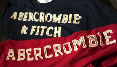 In this Nov. 14, 2011 photo, Abercrombie & Fitch sweat shirts are displayed at a store in Phoenix. When it comes to flying, it seems that Abercrombie & Fitch CEO Michael S. Jeffries is