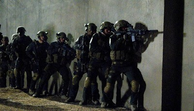 """This film image released by National Geographic Channels shows actors portraying members of SEAL Team Six who raided the compound of Osama Bin Laden in """"SEAL Team Six: The Raid on Osama"""