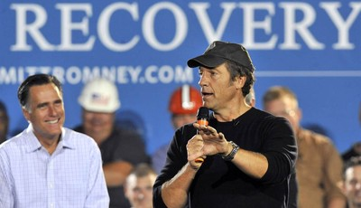 "FILE - In this Sept. 26, 2012 file photo, Republican presidential candidate, former Massachusetts Gov. Mitt Romney listens as Mike Rowe, host of television show ""Dirty Jobs"" speaks duri"