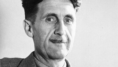 FILE - In this file photo, writer George Orwell poses in this undated photo at an unknown location. Pearson PLC will merge its Penguin Books division with Random House, which is owned b
