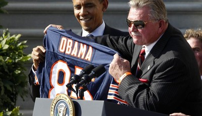 FILE - In this Oct. 7,2011 file photo, former Chicago Bears head football coach Mike Ditka presents President Barack Obama with a jersey as the 1985 Super Bowl XX Champions Chicago Bear