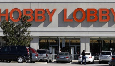 Customers walk to a Hobby Lobby store in Dallas on Thursday, Nov. 1, 2012. The arts and craft supply company owned by a Christian family asked a judge Thursday, Nov. 1, 2012 to block a