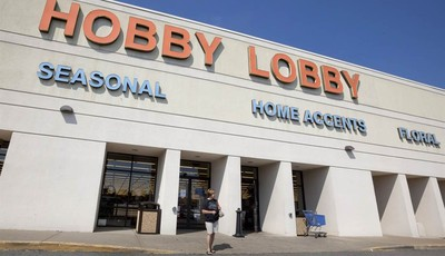 FILE - In this Sept. 12, 2012 file photo, a woman walks from a Hobby Lobby Inc., store in Little Rock, Ark. Hobby Lobby Stores, the arts and craft supply chain that wants to block enfor