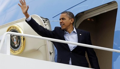 President Barack Obama waves as he boards Air Force One before his departure from Andrews Air Force Base, Sunday, Nov. 4, 2012. Just two days from the finish, Obama