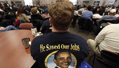 In this Nov. 6, 2012 photo, United Auto Workers member Harry Van Uden attends a rally on Election Day at the UAW Region 1 technical training center in Warren, Mich. Only a couple of wee