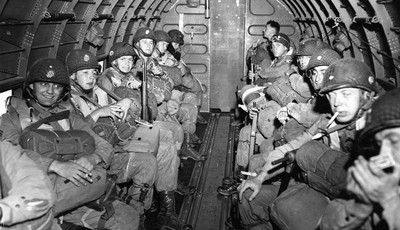 FILE - American Paratroopers fly over the English Channel enroute to play a key role in the invasion of France by landing along a 100 mile front of the Normandy coast on June 6, 1944. (