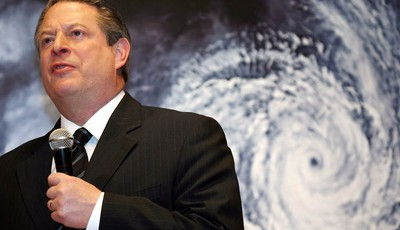 """FILE - In this Monday, Jan. 15, 2007 file photo, former U.S. Vice President Al Gore speaks in front of a poster for his documentary film on global warming, """"An Inconvenient Truth,"""" duri"""