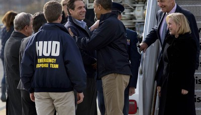 President Barack Obama is greeted by New York Gov. Andrew Cuomo upon his arrival at JFK International Airport in New York Thursday, Nov. 15, 2012, before taking a aerial tour of damage