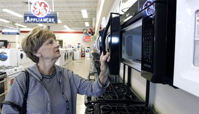 In this  Thursday, Oct. 25, 2012,  photo, Mary Ann Rotolo shops for a microwave oven at Orville