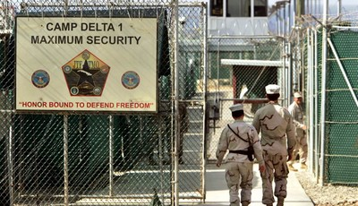 FILE - In this June 27, 2006 file photo, reviewed by a U.S. Department of Defense official, U.S. military guards walk within Camp Delta military-run prison, at the Guantanamo Bay U.S. N