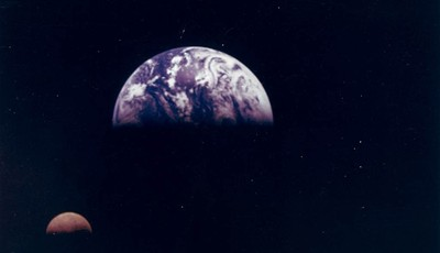 """FILE - This Dec. 16, 1992 file photo captured by the Galileo spacecraft and provided by NASA shows the moon, lower left, in orbit around Earth. NASA, the agency that epitomized the """"Rig"""