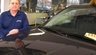 Joe Settineri , owner of Merrick Dodge Chrysler Jeep of Wantagh, N.Y., stands beside a recently sold Jeep. The car dealer says sales have been extraordinary in the weeks since Superstor