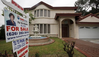 "In this Thursday Nov. 8, 2012, photo, a house is shown ""for sale"" in Monterrey Park, Calif.  Average U.S. rates on fixed mortgages ticked up this week just slightly above their record l"