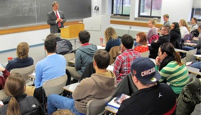 In this Nov. 27, 2012 photo Marquette University professor Tim Machan teaches a class on J.R.R. Tolkien that focuses on all of his books, books that influenced Tolkien and other tidbits