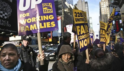 FILE - In this Wednesday, Dec. 12, 2012 file photo, cleaners, porters and matrons of theater union SEIU Local 32BJ demonstrate outside the Broadway League