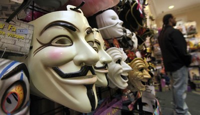 "FILE - In this Oct. 21, 2011 file photo, masks, including ""V for Vendetta,"" left, are displayed at a Ricky"