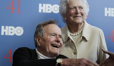 FILE - In a Tuesday, June 12, 2012 file photo, former President George H.W. Bush, and his wife, former first lady Barbara Bush, arrive for the premiere of HBO
