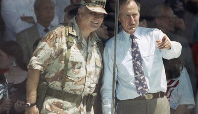 FILE - In this June 8, 1991 file photo, Gen. Norman Schwarzkopf and President George Bush watch the National Victory Parade from the viewing stand in Washington. Schwarzkopf led his tro