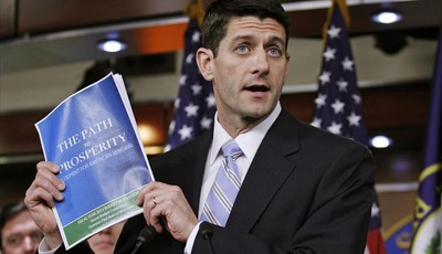 """House Budget Chairman Ryan shows a copy of """"The FY2013 Budget - The Path to Prosperity"""" during a news conference at Capitol Hill in Washington"""
